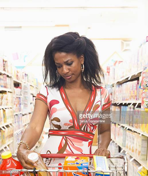 African American woman shopping for groceries in store