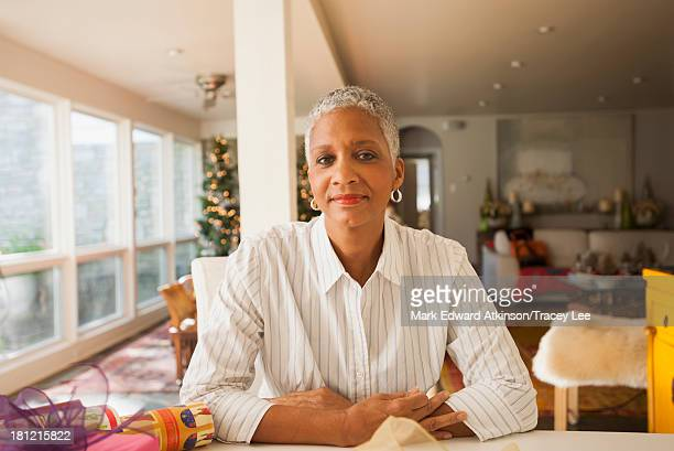 African American woman sitting at table