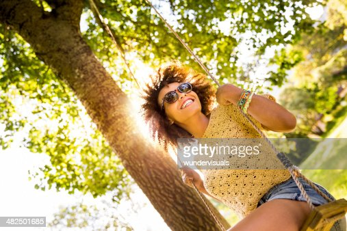 african american woman sitting on a swing
