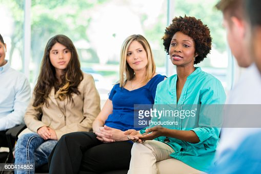 African American woman speaking during group therapy