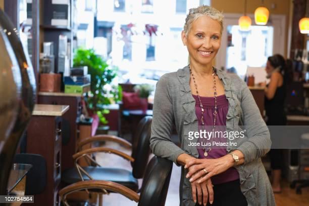 African American woman standing in beauty salon