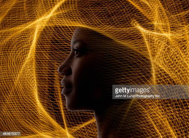 African American woman surrounded by golden netting