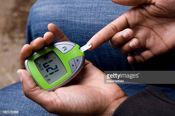 African American Woman Tests Blood Sugar