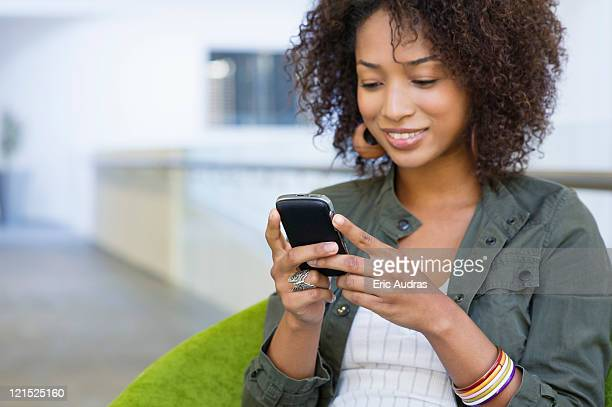 African American woman using mobile phone in university