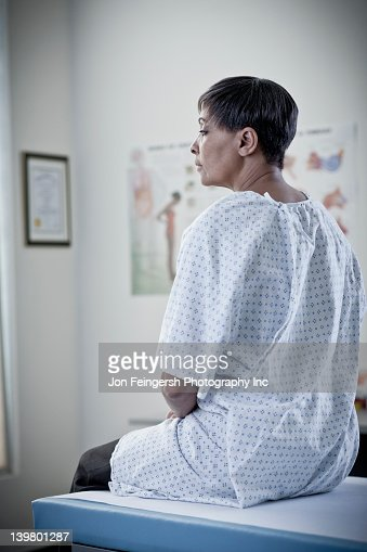 African American woman waiting in examination room : Stock Photo