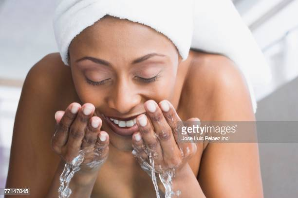 African American woman washing face