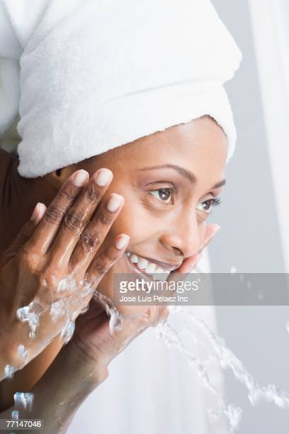 African American woman washing face