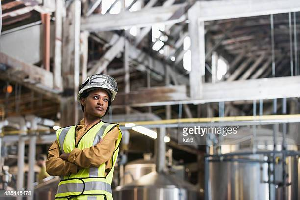African American woman wearing hardhat and safety vest