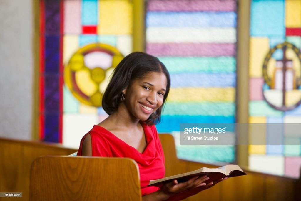 African American woman with Bible in church : Stock Photo