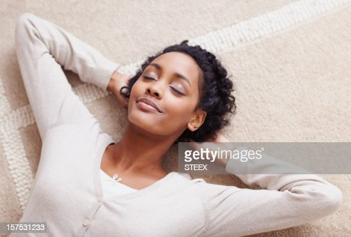 African American woman with her eyes closed relaxing
