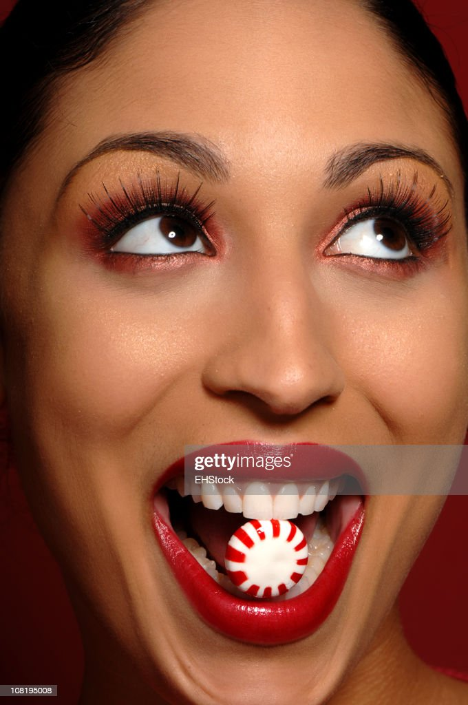African American woman with Peppermint Candy in Mouth