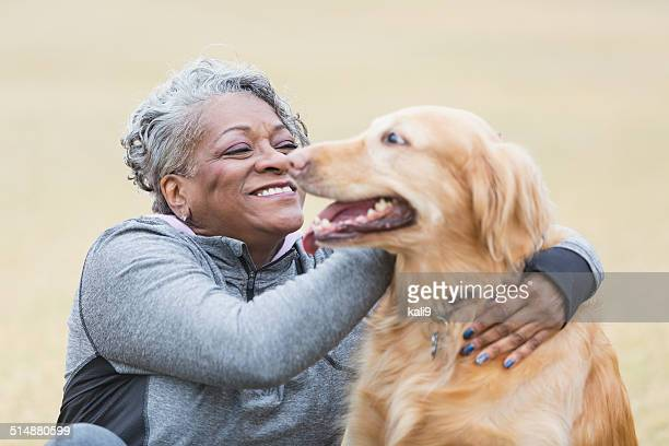 African American woman with pet dog