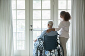 African American woman with Senior man in wheelchair