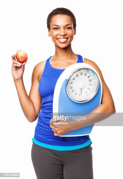 African American Woman With Weight Scale And Apple - Isolated