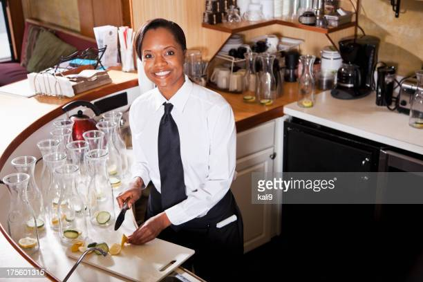 African American woman working in restaurant