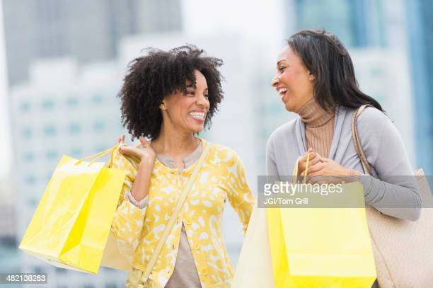 African American women shopping on city street