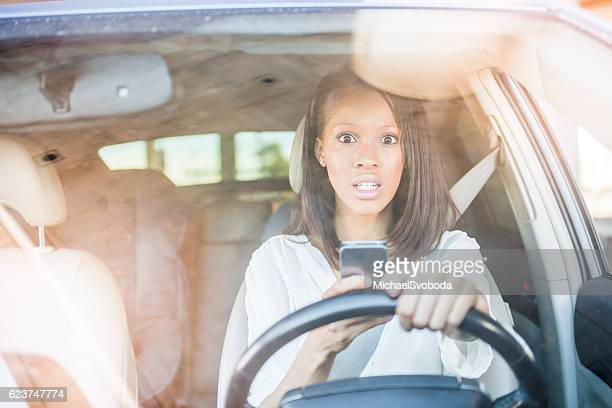 African American Women Surprised Texting In A Car