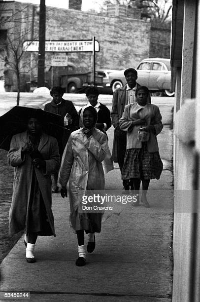 African American women walk along the sidewalk during a bus boycott Montgomery Alabama February 1956