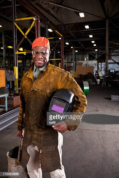 African American worker in fabrication shop