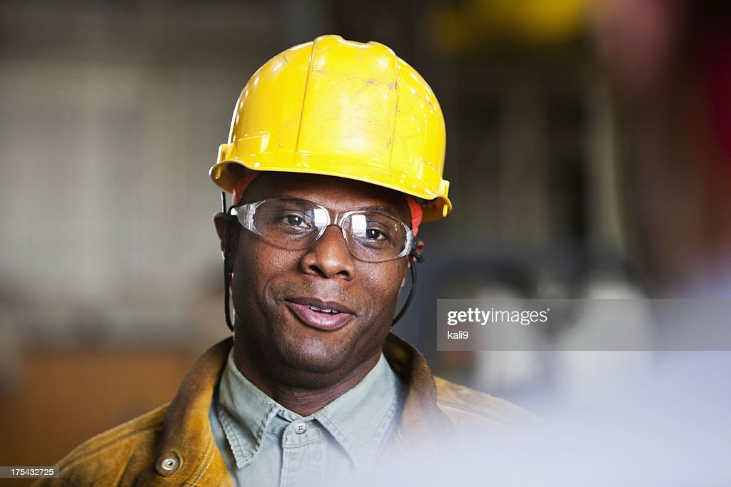 African American worker talking to co-worker