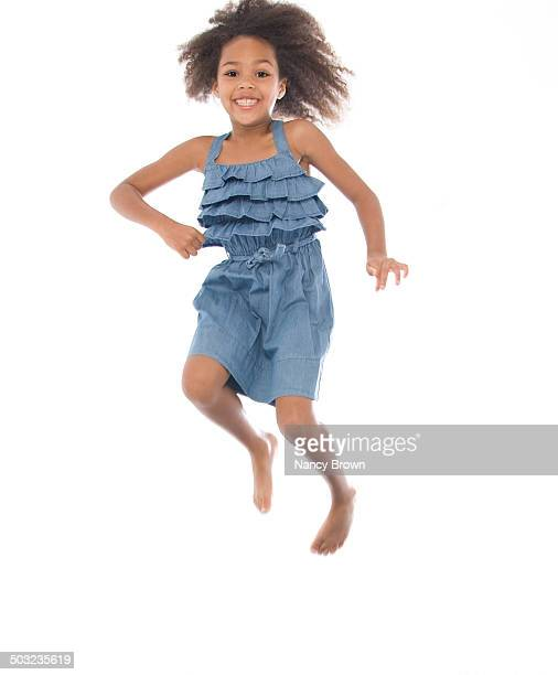 African American Young Girl Jumping for Joy.