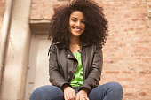 African american young woman smiling outdoors