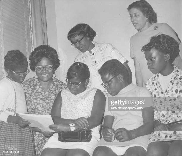 African American youth speak with members of Alpha Kappa Alpha who paid for them to attend Job Corps a program of Lyndon Johnson's War on Poverty 1968