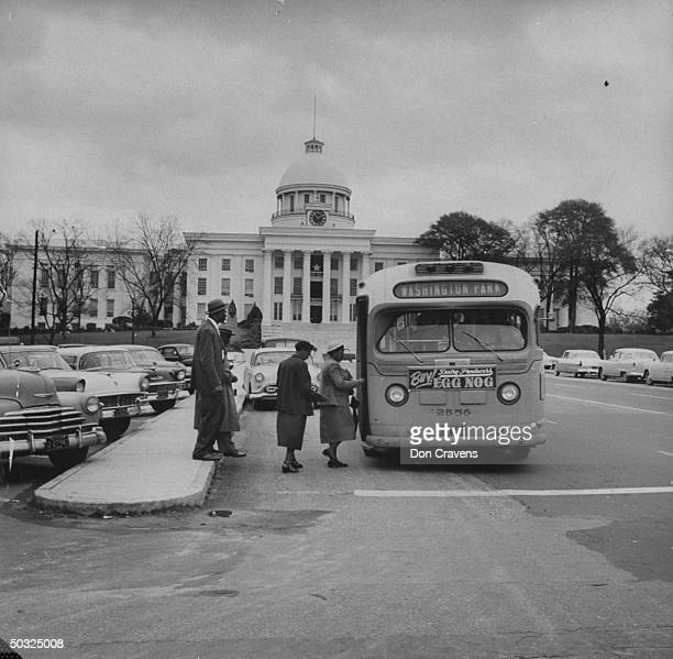 African Americans boarding a newly integrated bus through the onceforbidden front door following Supreme Court ruling ending successful 381 day...