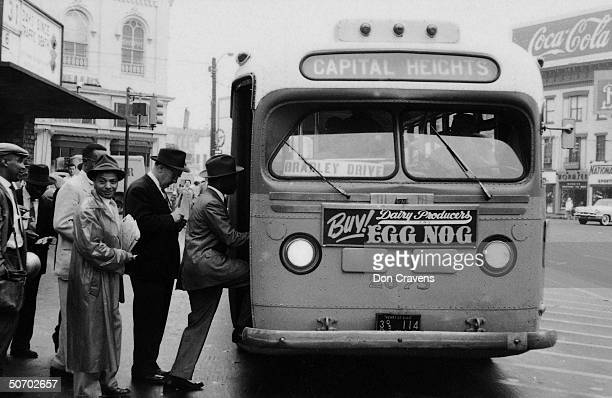 African Americans boarding bus at end of bus boycott