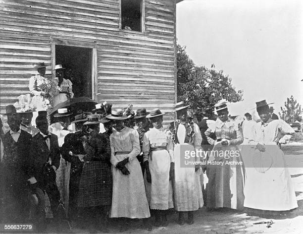 African Americans posed outside of church Negro life in Georgia USA compiled and prepared by WEB Du Bois