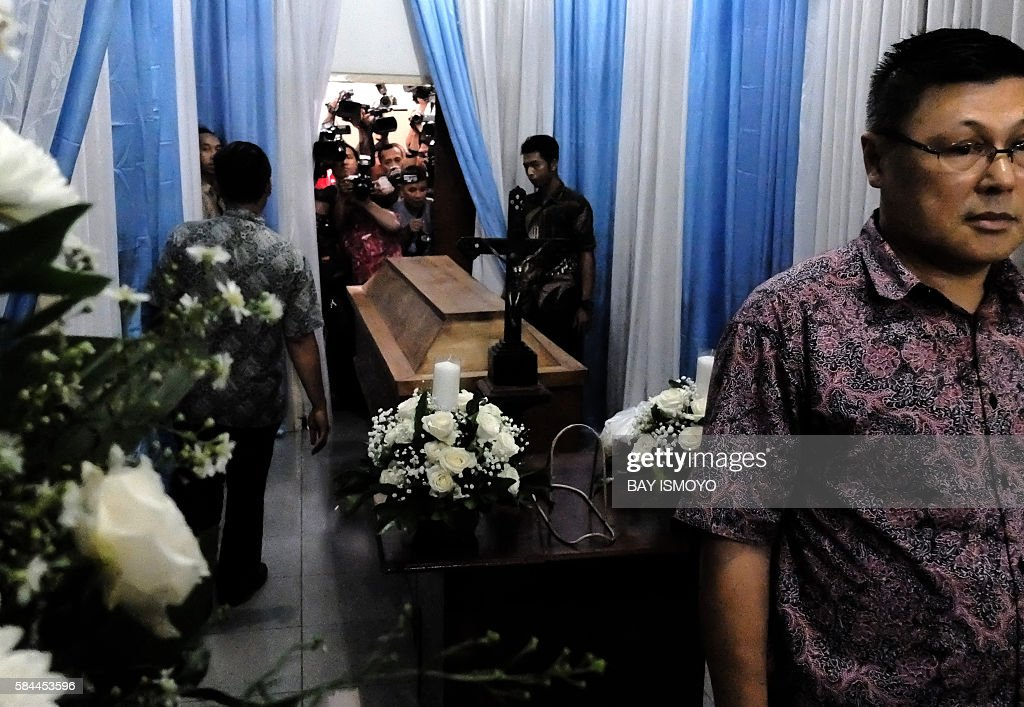 TOPSHOT African and Indonesian relatives of Nigerian drug convict Sech Osmane gather at Saint Carolus hospital morgue in Jakarta on July 29 2016...