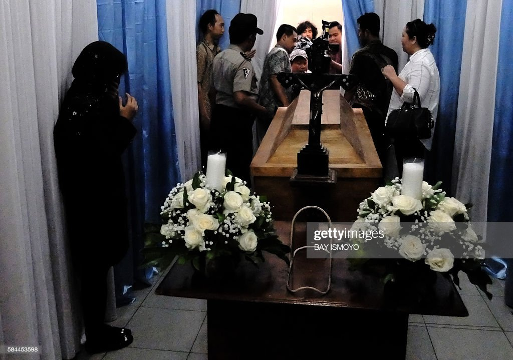 African and Indonesian relatives of Nigerian drug convict Sech Osmane gather at Saint Carolus hospital morgue in Jakarta on July 29 2016 after his...