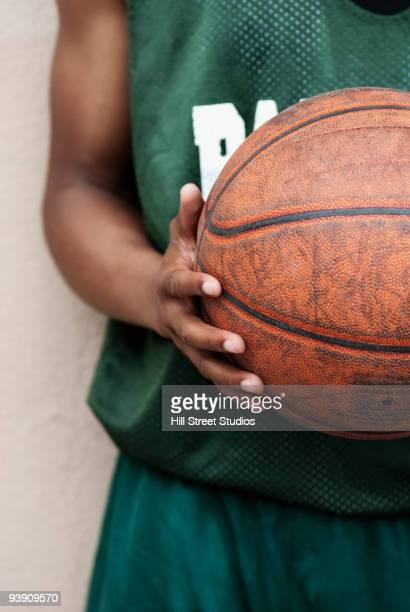 African basketball player holding ball