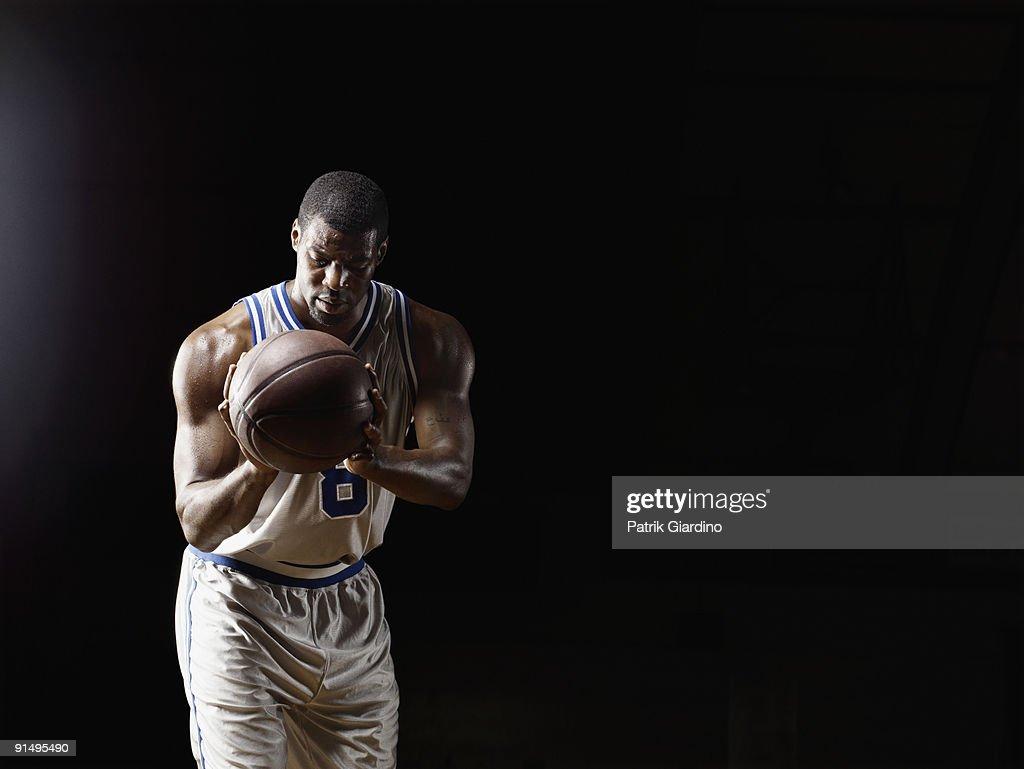 African basketball player holding basketball : Stock Photo