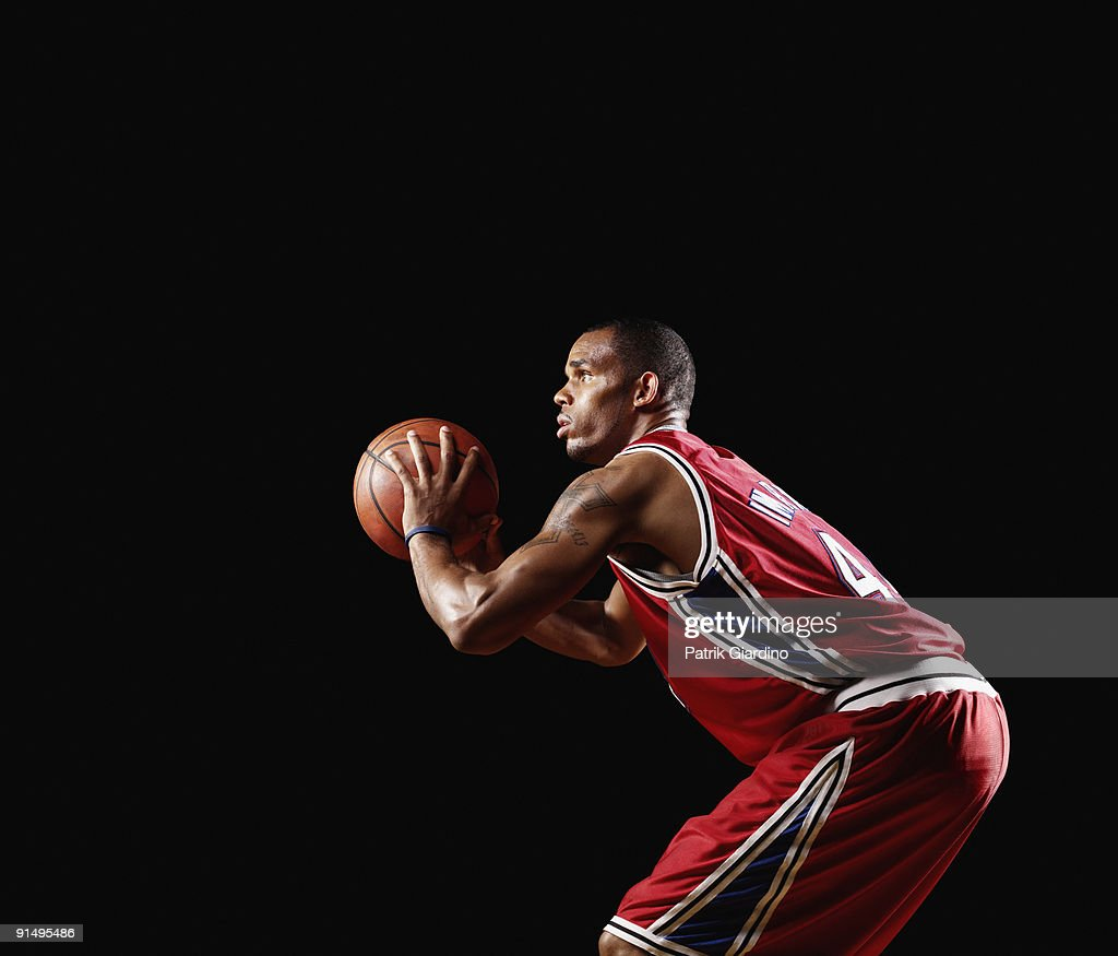 African basketball player shooting basketball : Stock Photo