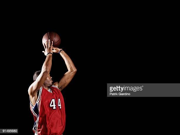 African basketball player shooting basketball