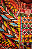 Detail of a beaded necklace worn by a tribal woman from Kenya.