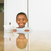 African boy at breakfast table