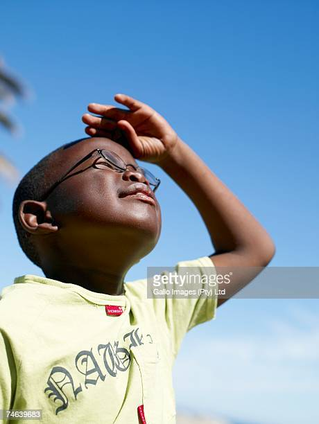 African Boy Looking Up to the Sky