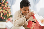 African boy opening gift