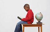 African boy reading book