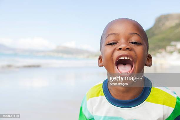 African boy shouts at the camera using soft focus