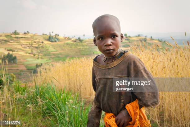 African boy walking in the fields of Rwanda
