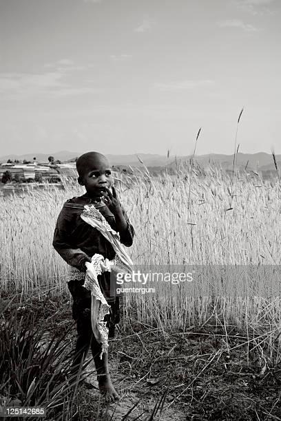 African boy walking in the fields of Rwanda