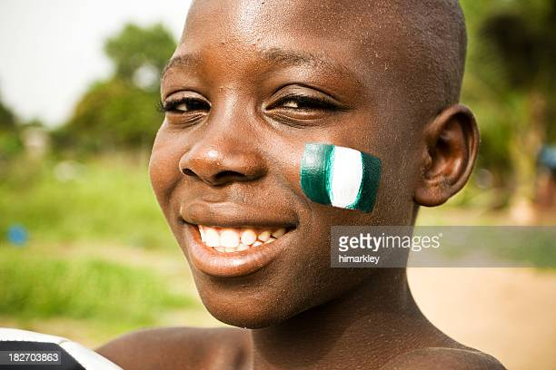 African boy with flag of Nigeria on a cheek