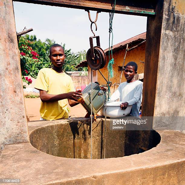 african boys on the well