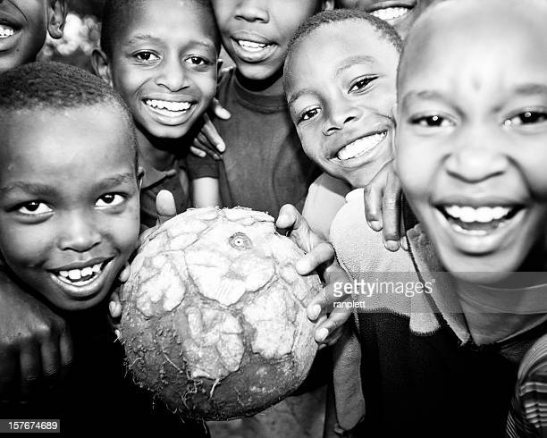 African Boys Smiling with a Soccer Ball
