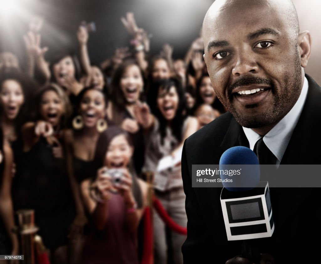 African broadcaster at red carpet event : Stock Photo