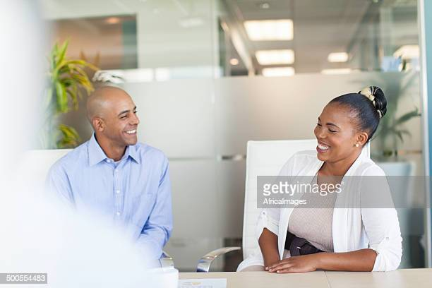 African business colleagues having a conversation in the boardroom