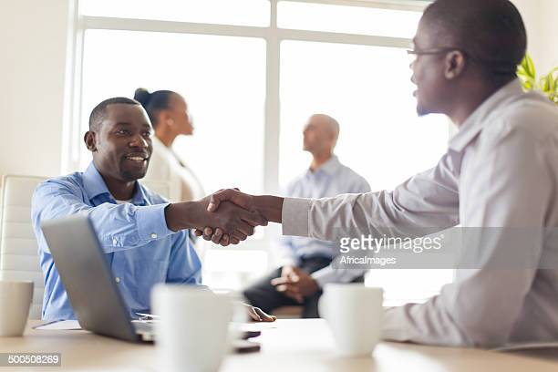 African business colleagues shaking hands after making an agreement